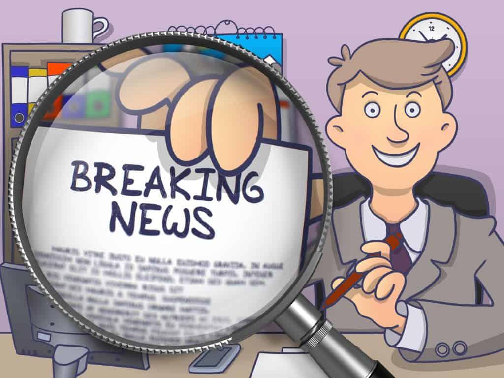 Man holding sign saying breaking news